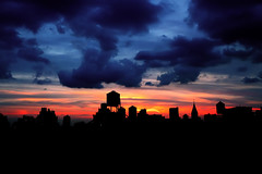 'Goodbye Cumulus Nimbus', West Village Skyline, NYC (WanderingtheWorld (www.LostManProject.com)) Tags: new york city nyc sunset sky sun storm west tower church water colors silhouette skyline clouds canon buildings high downtown village dynamic manhattan vibrant awesome horizon surreal steeple western sublime range watertank hdr ceder dissipation 50d flickrsbest colorphotoaward