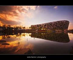 Storms Brewing.... (eddie_fletch) Tags: china sunset bw reflection birds clouds long exposure nest stadium 10 110 beijing sigma stop filter olympics chao 1020mm dramaticsky olympicstadium drifting sigma1020mm cokin niao p121 sigma1020 beijingolympics nd110 nd30 ndgradfilter canon40d 10stopfilter ctrippic