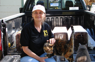 Woman with a cat who will be TNR'd in Mayport, Florida