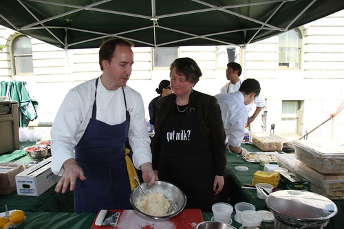USDA Deputy Secretary assists Chef Eric Ziebold with a cooking demonstration at the kick-off of the USDA Summer Farmers Market.