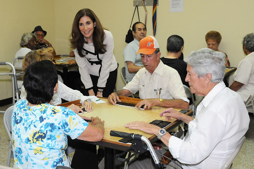 Deputy Administrator for SNAP Lisa Pino talks with senior citizens as they play Cuban dominos at the Little Havana Activities and Nutrition Center in Miami.   (USDA photo by Debbie Haston-Hilger).