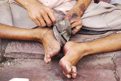 the shoe mender (handheld-films) Tags: india streets feet shoes indian streetphotography repair barefeet mend cobbler rajasthan imagesofindia subcontinent ruralindia indianstreetphotography indiaandindians portraitsofindia lifeinindia handheldfilms indiaphotojournalism