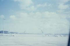 覺得抽再多的菸也沒用。 (Kerb 汪) Tags: sky film japan airport nippon kerb airnewzealand airplan 関西国際空港 agfaoptima1035 agfaoptimasensor konicacenturia200 kanseiairport alitaliaairlines 24數碼服務 數碼3744 agfaoptima1035film016 negative02120a kerbwang
