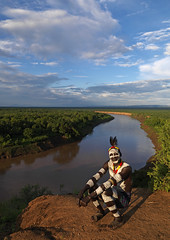 Karo man tribe in front of Omo river - Ethiopia (Eric Lafforgue) Tags: africa travel sky people kara river exterior artistic outdoor couleurs african helmet tribal adventure ciel ornament blackpeople omovalley bodypainting ethiopia tribe ethnic rite karo bun ethnicity headdress adornment afrique pigments headwear headgear tribu ethiopian omo eastafrica abyssinia ethiopie blackskin exterieur gebre tribalportrait colorpicture ethnique abyssinie ethnie omoriver photocouleur kolcho southethiopia afriquedelest nomadicpeople colourpicture korcho cluleur ethiopiedusud valleedelomo clayhelmet peoplesoftheomovalley 06269