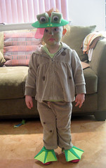 full-length shot of toddler dressed as a frog