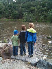 three boys by the river