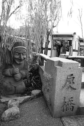 Spirit figure and bridge at Seimei Jinja Shrine