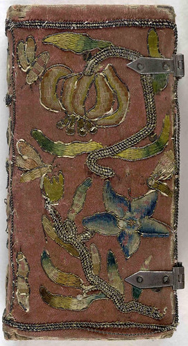 Front cover of 17th century embroidered satin book with two sets of metal clasps.