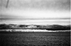 Sel[fish] (ironicmoka - The catcher in the eye) Tags: light sea italy seascape black film clouds blackwhite nikon italia nuvole mare bn cielo acqua luce biancoenero 2010 pellicola nikonf801 fotografinewitaliangeneration nicolaparoldo