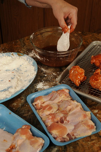 Dip coated wings into sauce mixture