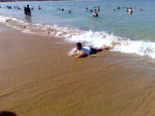 Tom body surfing