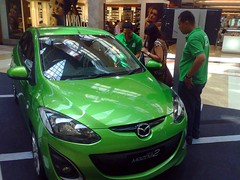Green Mazda (Mangiwau) Tags: green ford car mobile mall japanese display sale pim indah mazda pondok sporty hijau kecil pimi pim2 pimii carmaker pim1