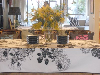 Tablescape with dogwood branches and mimosa flowers