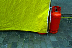 Yellow awning (house of bamboo) Tags: leica red lines yellow awning d double cobbles canister lux creased