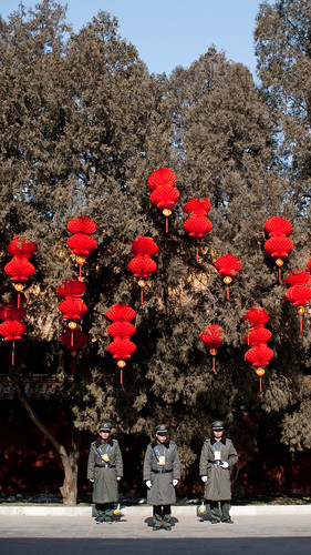 Red lanterns above security guards