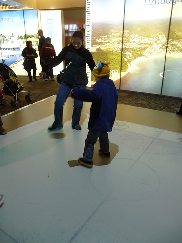 playing hockey on the interactive floor at Russky Dom