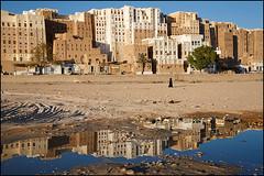 reflection - Shibam (Maciej Dakowicz) Tags: city travel house reflection building tourism water architecture sand asia desert traditional unesco oasis arabia historical yemen shibam