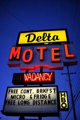 Delta Motel (scott_z28) Tags: old classic sign night mi vintage hotel neon michigan motel gone 1950s roadside googie demolished torndown baycity removed tricities deltamotel