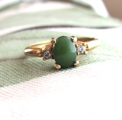 Jade centered vintage cocktail ring with faux diamonds, designed by Avon (MySoCalledVintage) Tags: fashion metal vintage real gold mod designer jewelry womens retro cocktail jade 1950s faux accessories etsy rhinestone avon genuine midcentury madmen rhinetones mysocalledvintage