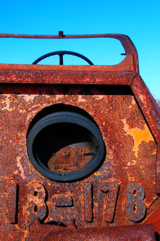 A rusty truck front, with the numbers 18-178 in metal.