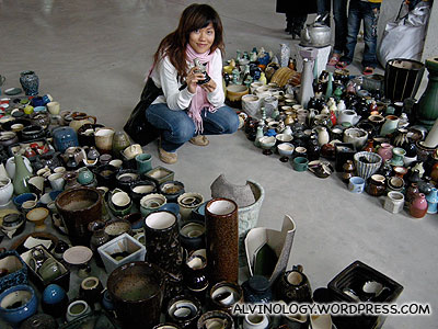 Rachel looking through the ceramic items