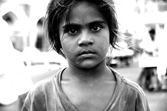 innocence (Mark Lapwood) Tags: poverty boy portrait india white black girl face kids eyes child sister brother homeless under poor steps young dirty sidewalk walkway bombay roadside mumbai footpath survival pathway chldren privileged