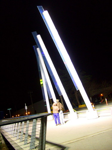 Couple stops to admire the public art structure outside the Richmond Olympic Oval