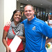 Kevin Griffin, women's head basketball coach, greets a student in the registration line.