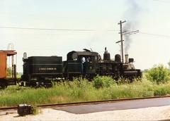 Illinois Railway Museum's Shay locmotive # 5 pulling an eastbound caboose train. Union Illinois. July 1996.