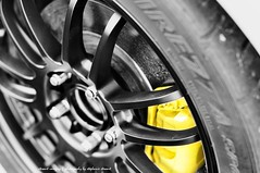 These are the (Yellow) Brakes! (Stewart Imagery) Tags: blackandwhite car wheel yellow 50mm automobile details brakes s2k selectivecolor caliper hondas2000 d90 nikond90