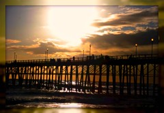 The Beautiful Sun Setting Over the Ocean (Teresa Miladin) Tags: ocean california travel sunset beautiful pier waves scenic beaches sunsetting oceansidecalifornia vacationsite