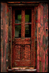 The Red Door (Junkstock) Tags: door wood old red color texture abandoned rural vintage photography photo junk paint doors photos decay rustic maine newengland textures photographs photograph kennebunkport weathered aged peelingpaint distressed patina ruralexploration oldandbeautiful agedwindow