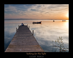Looking for the light (cesarmarch) Tags: sunset valencia landscape atardecer spain pareja paisaje olympus embarcadero e3 barcas reflejos albufera 1260 cesarmarch