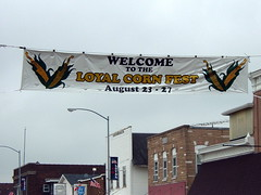 Corn Fest Banner In Downtown Loyal, Wisconsin. (dccradio) Tags: carnival festival downtown event entertainment cornfestival amusements cornfest loyal indianhead rurallife communityevent farmcommunity loyalwisconsin indianheadamusements downtownloyal loyalcornfest