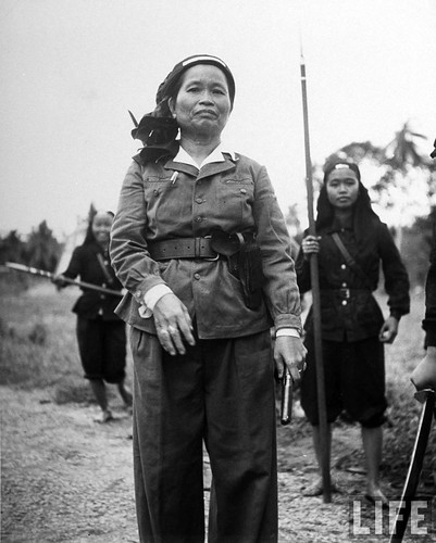 July 1948 - Women preparing to protect as members of the Hoa Hao women's troop.