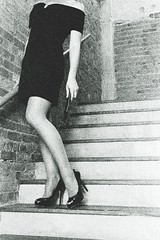 Amy C Stairwell B&W 1 (neohypofilms) Tags: wild urban blackandwhite bw cinema black cute sexy brick slr classic texture film leather 35mm vintage fun photography 50mm blackwhite model nikon exposure raw noir pumps dress legs sweet interior grain steps gritty stairwell retro photograph faux heels expired 3200 peeptoe patent 1sec 51610 neohypofilms