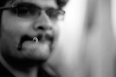 smokin' (knowsnotmuch) Tags: bw film 50mm dof cigarette nikonf100 t1 fuji160c vatsan chennaiphotowalk