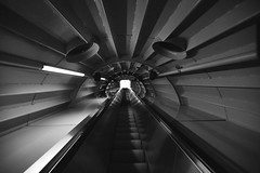 Stairway to heaven (Coggleswort00) Tags: light white black blackwhite escalator tunnel stairway 2010