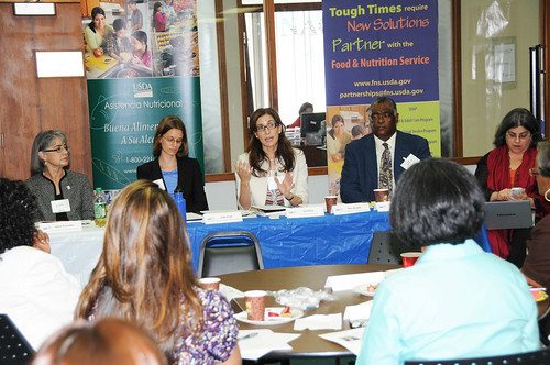 FNS Deputy Administrator for SNAP Lisa Pino (center),  USDA Center for Faith-Based and Neighborhood Partnerships Acting Deputy Director Julie Curti (left), and SERO Regional Administrator Donald Arnette (right), meet with local government leaders, hunger advocates, faith-based groups and community partners, June 3, during a roundtable in Miami.