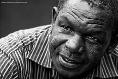 African Portrait - Ritratto africano (Stefano Mazzoni) Tags: portrait blackandwhite bw natal southafrica ancient nikon bokeh bn ritratto viaggio biancoenero mpumalanga reportage vecchio kwazulu fifaworldcup2010 stefanomazzoni windowsgod