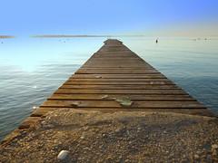 Lake wharf (Daniele Sala Photography) Tags: autumn sunset red italy sun lake holiday color water october garda seagull gulls autumncolors wharf gardalake lagodigarda gardasee veneto peschiera autumnsunset lakeofgarda peschieradelgarda platinumphoto anawesomeshot scaligero70