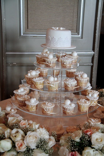 A lacey elegant theme of wedding cupcakes cakes