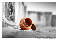 """Even a empty pot preserves our tradition. Do we?"" (Mayank Sharma renewed :D :D) Tags: bw orange white canon terrace indian culture pot indians tradition selectivecoloring"