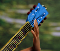 "Music for the soul (*Millie -""ON and OFF"") Tags: music playing guitar barbie hand paperbackground colors relaxation macromondays macro doll misha toys"