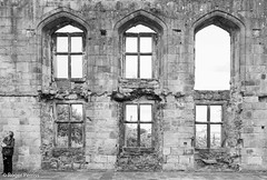 GREAT HALL WINDOWS, WINGFIELD MANOR, DERBYSHIRE_DSC_4633_LR_2.0-2 (Roger Perriss) Tags: wingfieldmanor manor swingfield blackandhwite d750 standing person windows hall greathall insertions adaption alteredwindows stonework masonry stone blocks c17 17thcentury slighted mansion englishheritage eh