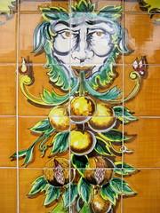fruited foliate head motif (giveawayboy) Tags: fruit tampa tile ceramic restaurant head decorative pomegranate columbia tiles citrus ybor azulejos grout foliatehead telha yborcity foliate paintedtile