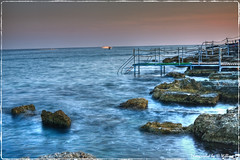 Lungomare Santa Maria di Leuca (william eos) Tags: desktop longexposure sunset sea summer vacation italy panorama sun holiday art beach nature water geotagged photography boat photo reflex interestingness mediterraneo barca italia raw tramonto blu tripod natura cielo wallpapers acqua azzurro lungomare paesaggi viaggio salento spiaggia luce vacanze scorcio scogli sfondo photografy meditazione viaggiare santamariadileuca photocard fineestate nicepictures bellefoto nicepicture finegiornata lungheesposizioni hoyand4 canoneos450d efs1855mmf3556is eos450 canoneos450 sfondiperdesktop williameos bellefotocolori williamprandi