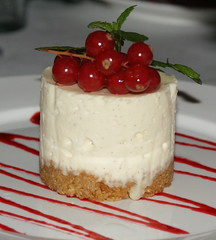 White chocolate cheesecake with raspberry coulis (Claire*D) Tags: food dessert pudding cheesecake whitechocolate a300 redcurrants raspberrycoulis