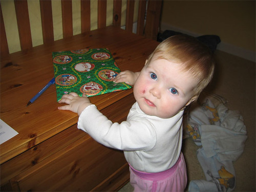 10-month-old Hannah wrapping Christmas presents