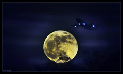 Fly Me To The Moon (Domain Barnyard) Tags: vegas moon airplane fly lasvegas aviation nevada flight happynewyear bluemoon tingey domainbarnyard canoneos5dmarkii overthetrees 12312009 20091231180308570800